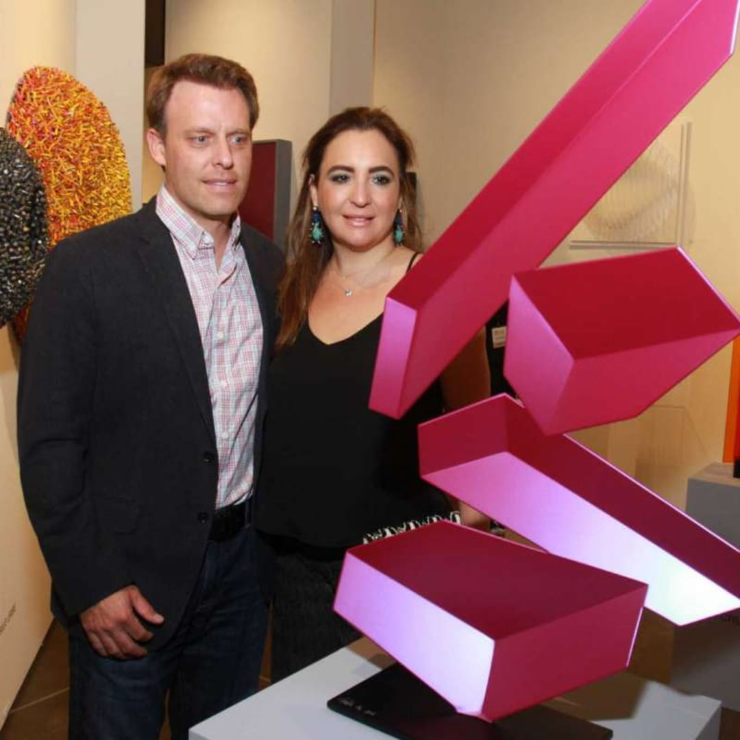 """Arturo and Paola Creixell with a piece by artist Rafael Barrios titled """"Tumble M388,"""" at the Houston Fine Art Fair at NRG Center. Gary Fountain/For the Chronicle"""