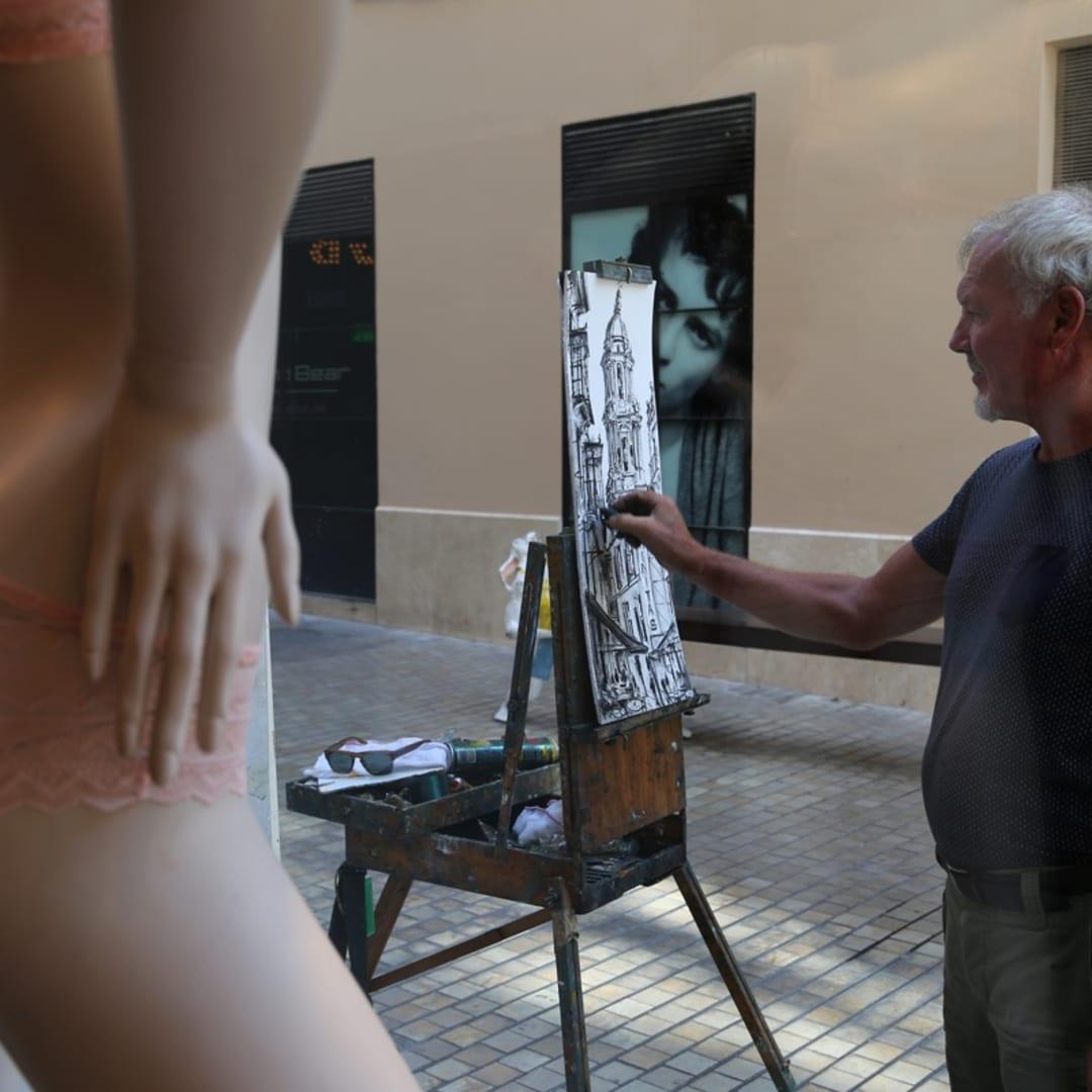 Gerard Byrne sketching plein air cityscape of Malaga, Spain