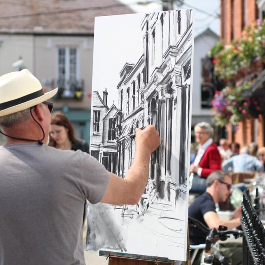 Gerard Byrne painting plein air Finnegans Pub, Dalkey, photo Colm Murphy