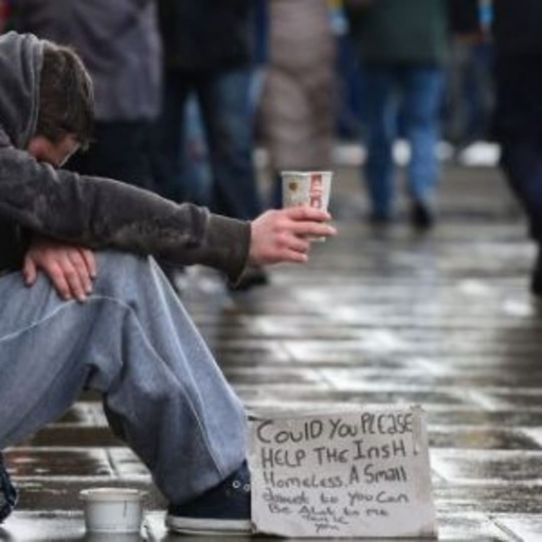 A homeless man. Westmoreland Street in Dublin. Photo credit The Irish Times / Alan Betson