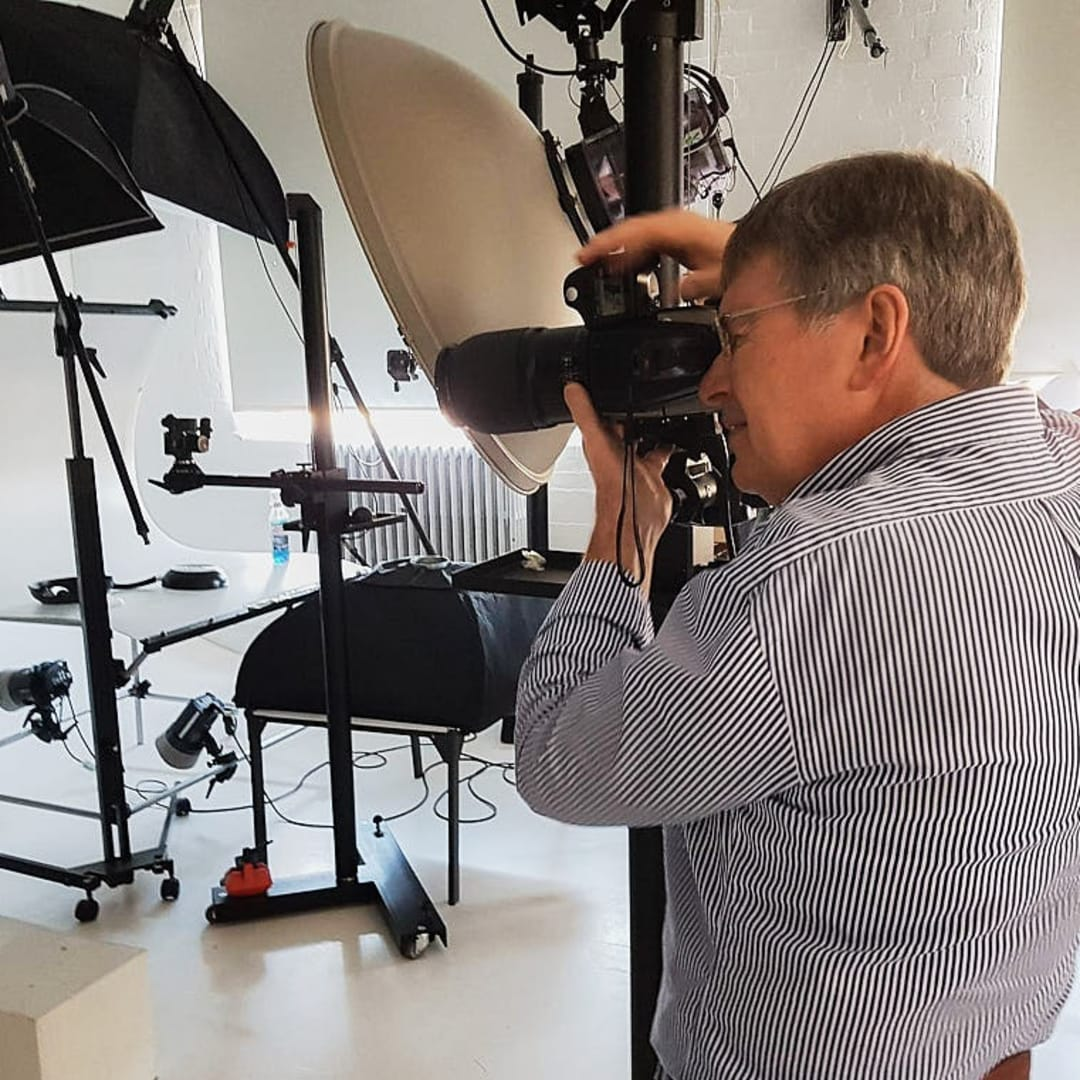 The Hasselblad camera mounted on a studio stand. This allows the camera to be moved both vertically and horizontally without moving the base. It is also a very stable platform because of the weight of the base