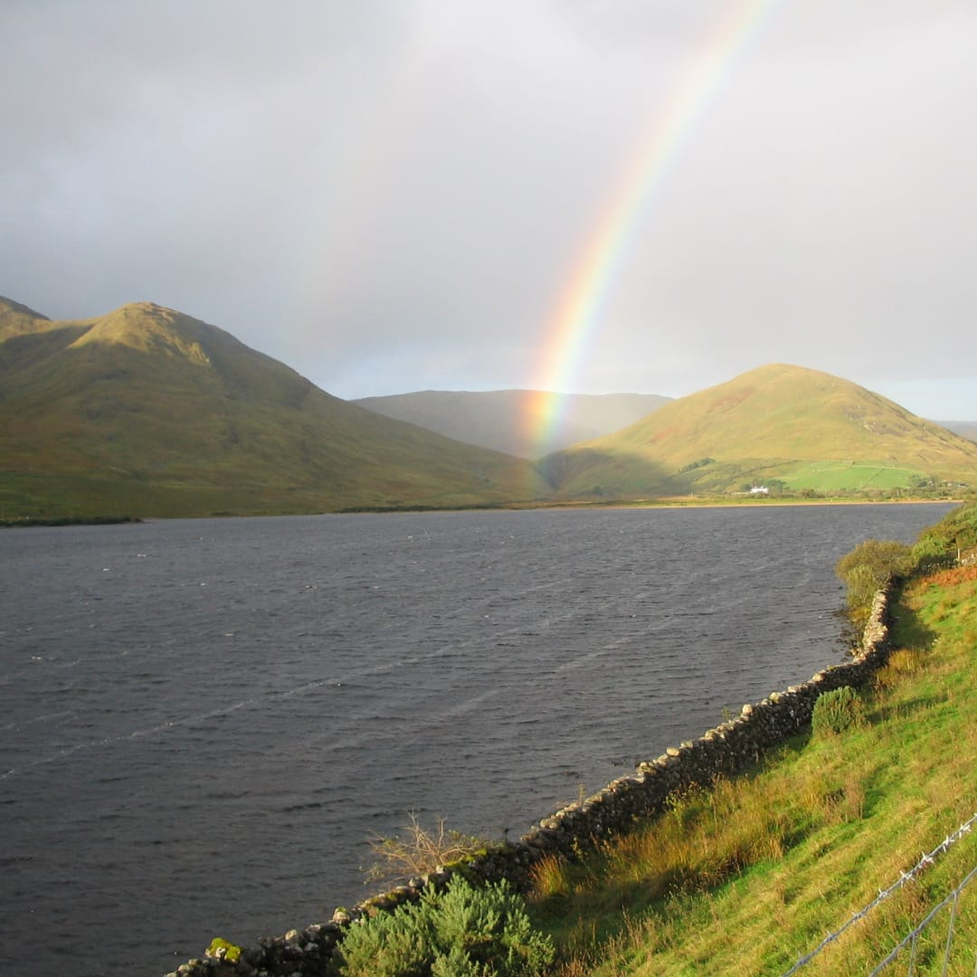 Rainbow on Loch na Fooey where the artist lives and works