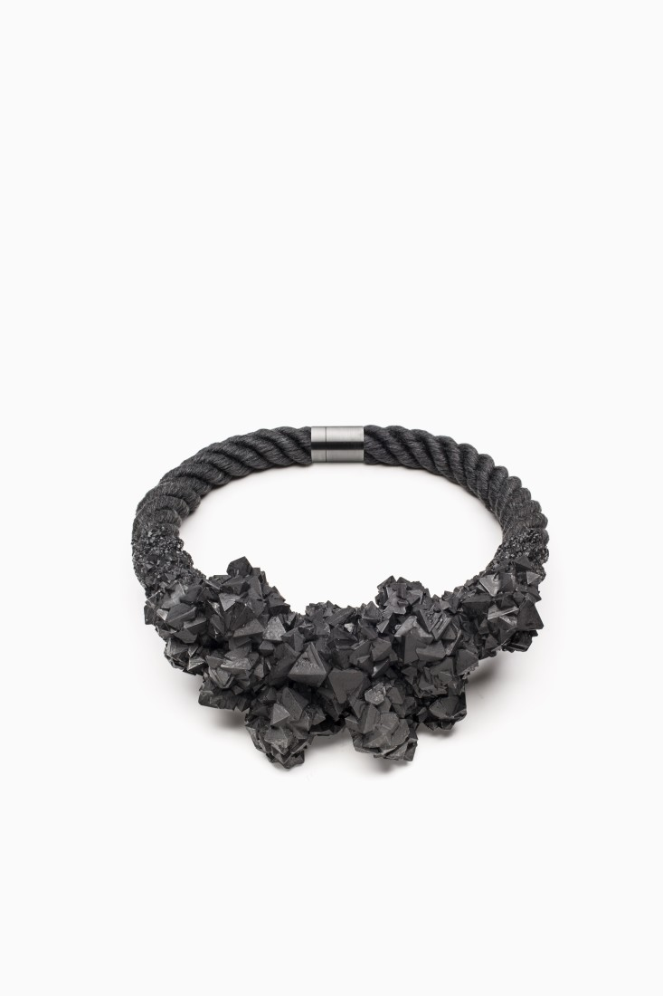 ZORYA Deamons are forever, 2011 Crystalized cluster necklace dyed linen flax rope, surgical-steel magnetic clasp, graphite-covered crystals Photo: Patrik Borecky,...