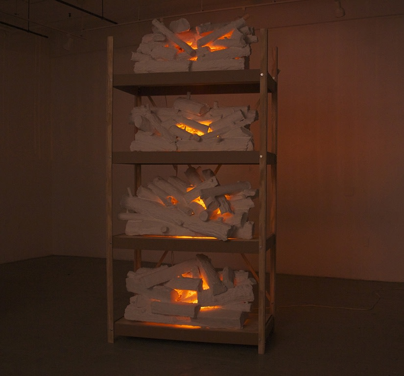 Tony Bragg, New Fire (shelves), 2014-2015  Hydrocal, foam, plywood, MDF, wire, reflective mylar, aluminum, motors, lightbulbs, and wiring, 108 x 50 x 26 in.  brag001