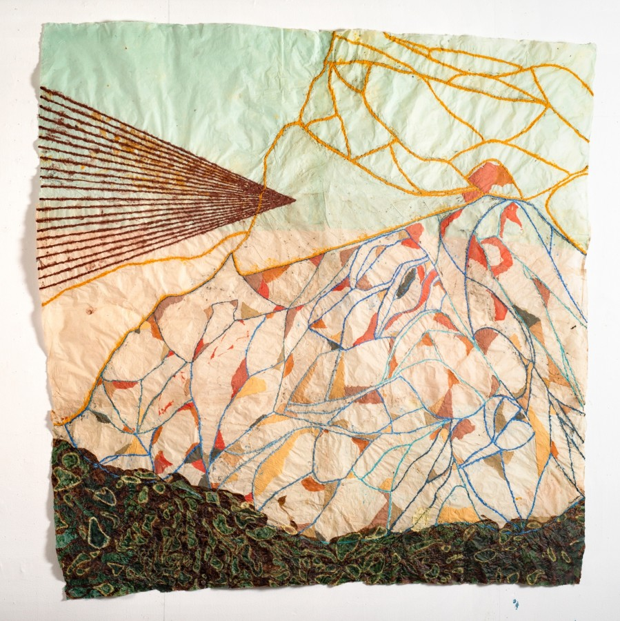 """Nancy Cohen's """"Breakwater"""" done with paper pulp and ink on handmade paper in various shades of brown, peach, orange, tan, blue and green. The piece depicts several design layers on the light orange and green paper creating a sense of depth."""