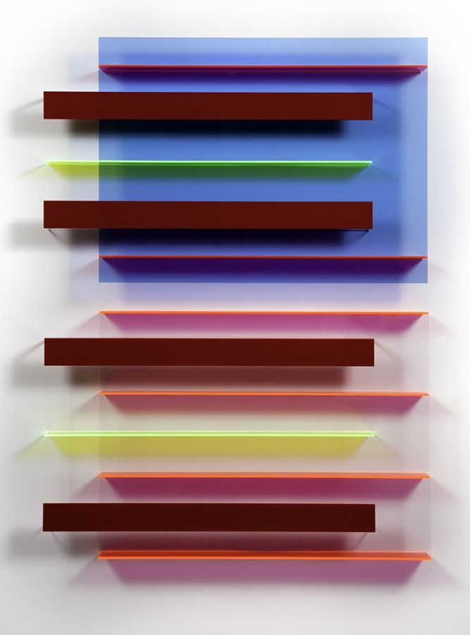 A work by Christian Haub done in cast acrylic sheet in brown, red, pink, blue and yellow color. The blue and yellow overlap each other creating green. From a bird's eye perspective, it resembles a rectangle pattern and strongly gives the work a 3-D effect