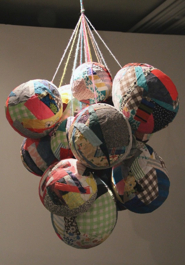 <p><strong>Eliza Fernand</strong></p><p><em>Remnant Balloon Balls</em>, 2011</p><p>reclaimed fabrics, paper, paste, yarn</p><p>40 x 30 x 30 in.</p>