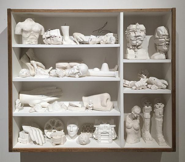 Eduardo Paolozzi - Wunderkammer, c.1990-2000, studio plaster casts, vitrine, 75 x 100 x 15cm