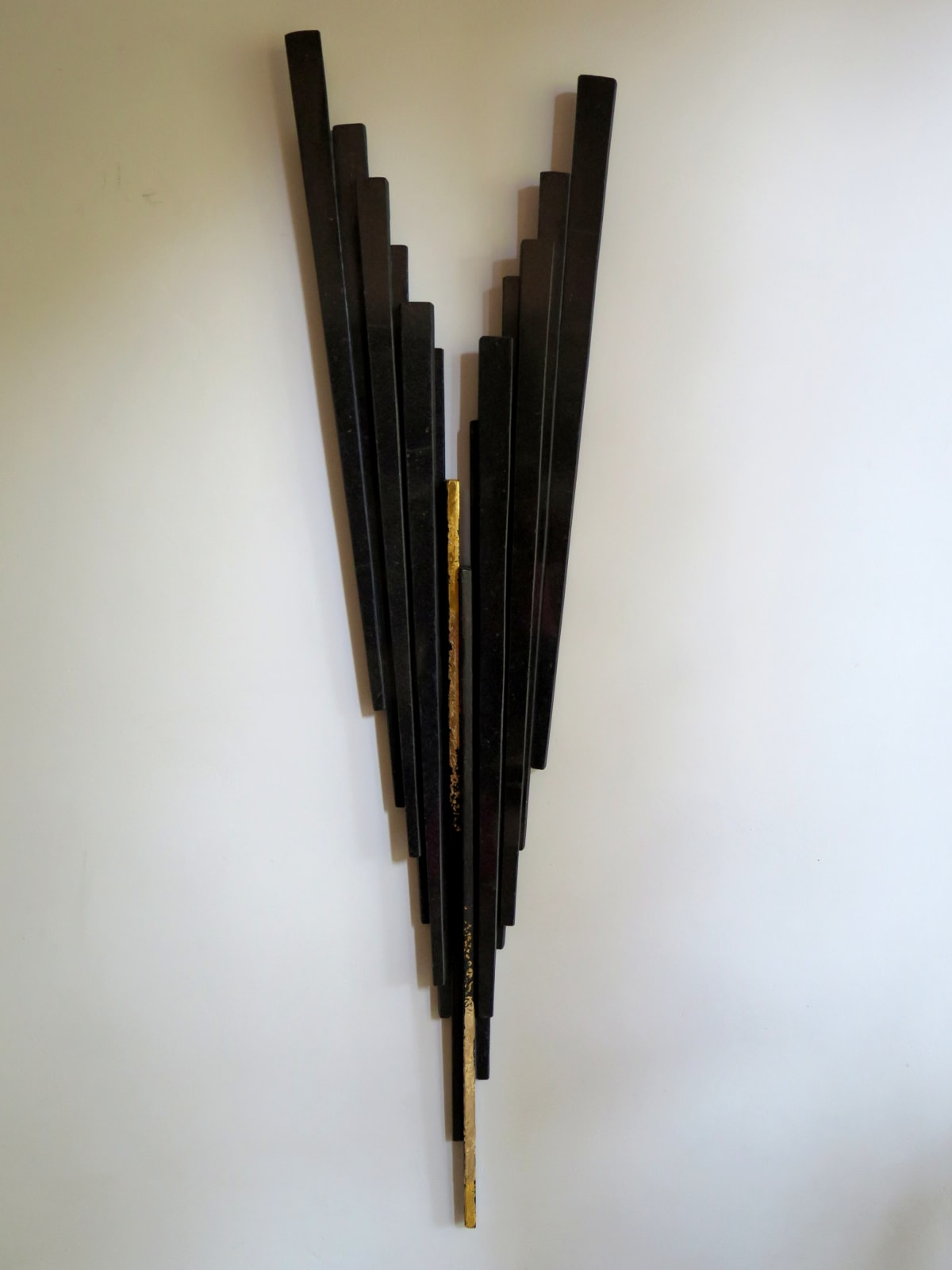 Gioni David Parra Bladelight Concert monumentale IX, 2018 Black granite and gold leaf. 178 x 46.7 x 7 cm (70.1 x 18.4 x 2.8 in)