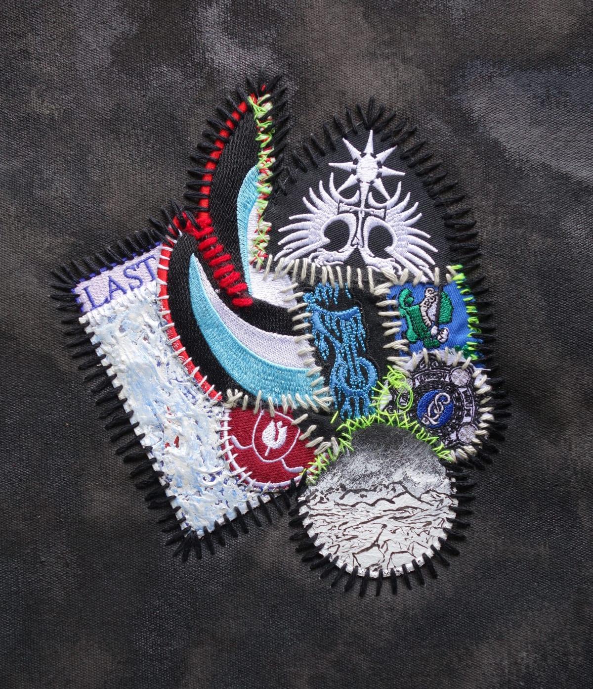 Stephen Eastaugh LAST ISLAND, 2015 Acrylic, wool, cotton badges, canvas wooden frame 410 x 330 mm