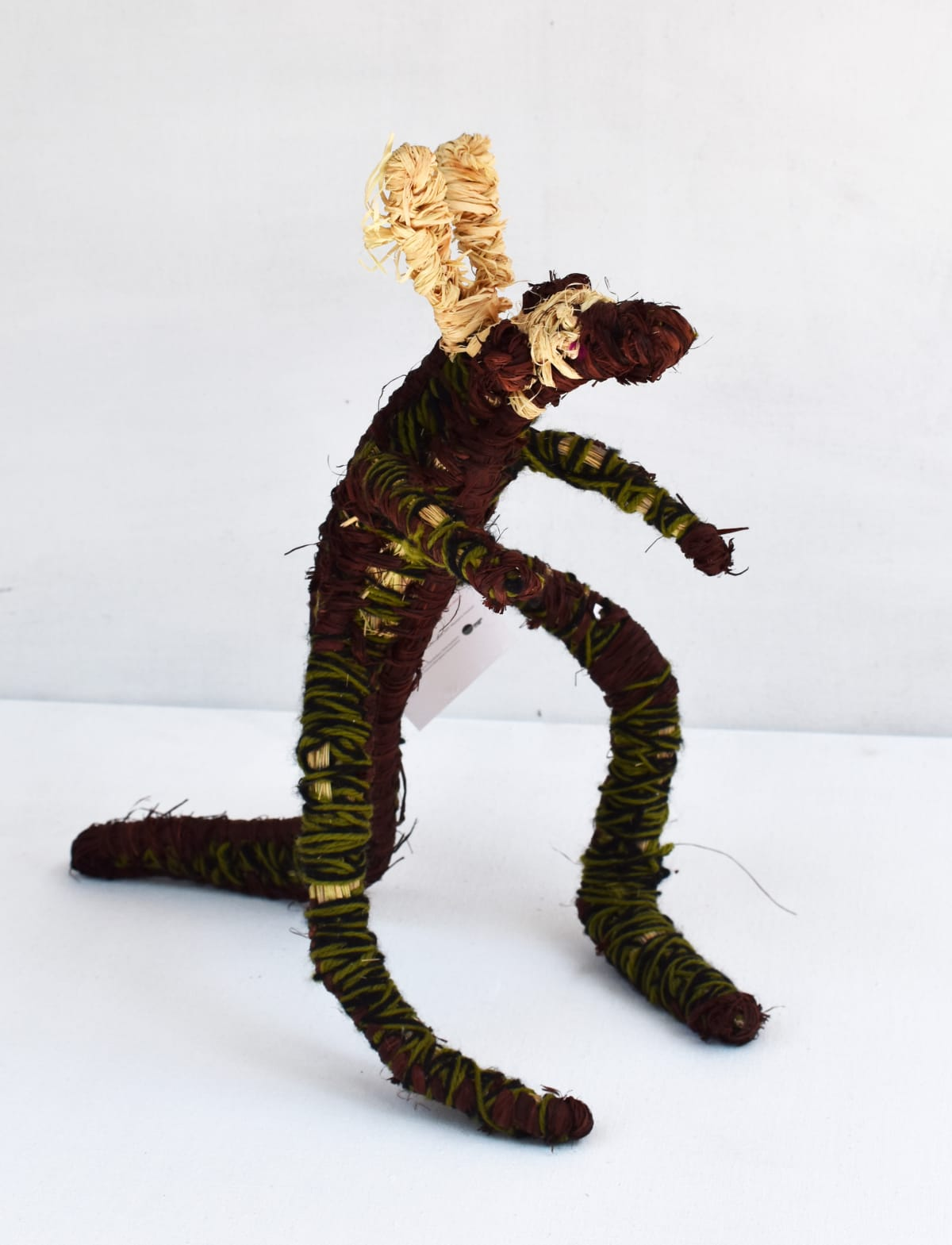 Atipalku Intjulka Malu tjanpi, raffia and yarn 36 x 20 x 38 cm