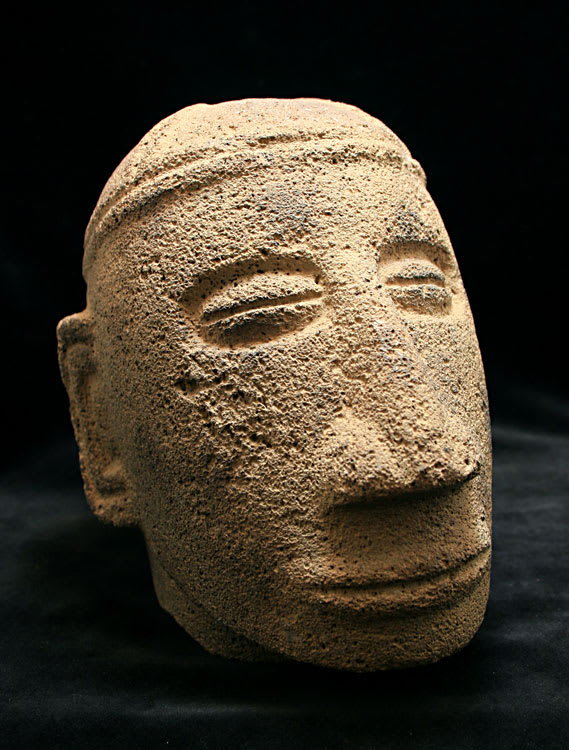 stone trophy heads