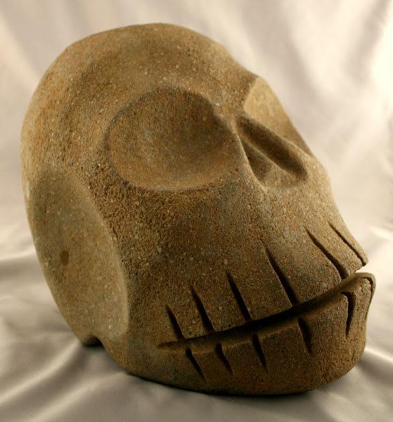 skull masks and sculptures