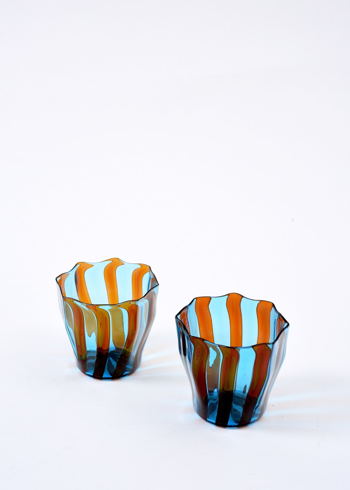 Campbell-Rey Amber and turquoise 'Rosanna' Murano tumbler Coloured Murano glass Height 8 cm Available in red and amber, red and blue, amber and turquoise, green and blue, green and turquoise. Made to order, lead time 4-6 weeks