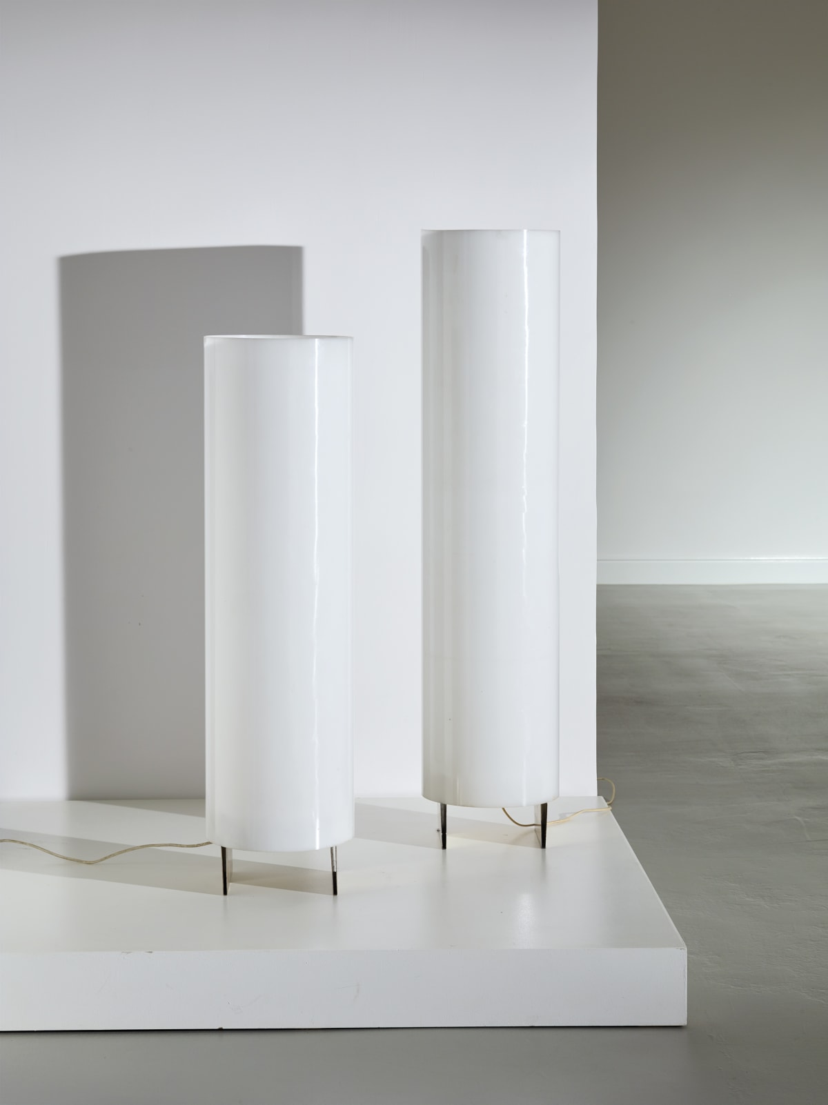 Lino Sabattini Pair of floor lamps 1975 Siver metal and perspex 112 x 30 cm; 134 x 30 cm Prototype for the artist's home