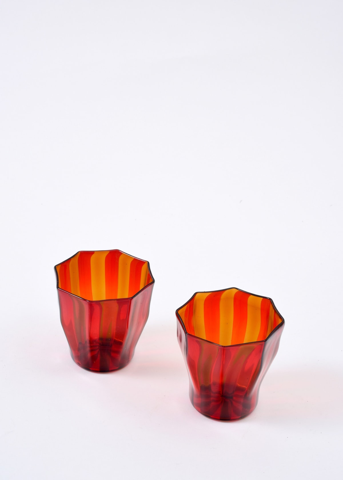 Campbell-Rey Red and amber 'Rosanna' Murano tumbler Coloured Murano glass Height 8 cm Available in red and amber, red and blue, amber and turquoise, green and blue, green and turquoise. Made to order, lead time 4-6 weeks