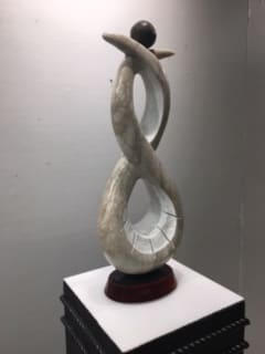 "Bryan Massey Balance, 2019 Alabaster and bronze 24"" x 9"" x 4"""