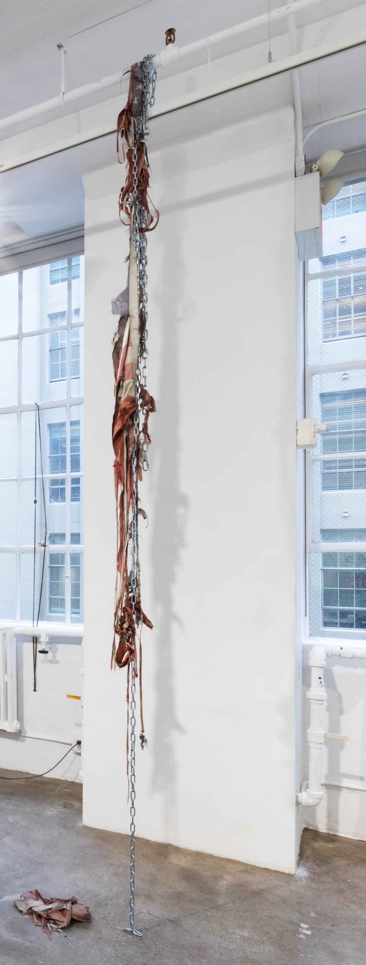 Carver Audain Untitled, 2019 3 found tattered flags, chains, toggle anchors 23 ft.