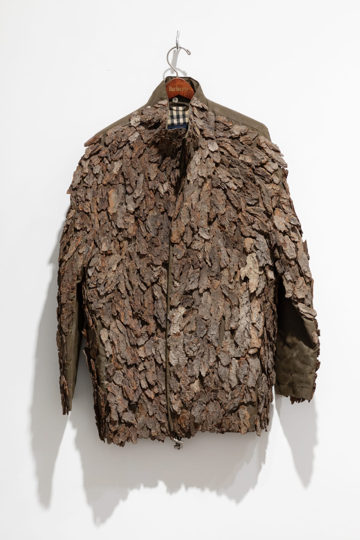 Hugh Hayden Armor, 2014 Cherry bark on Burberry coat 32 x 12 x 36 in 81.3 x 30.5 x 91.4 cm