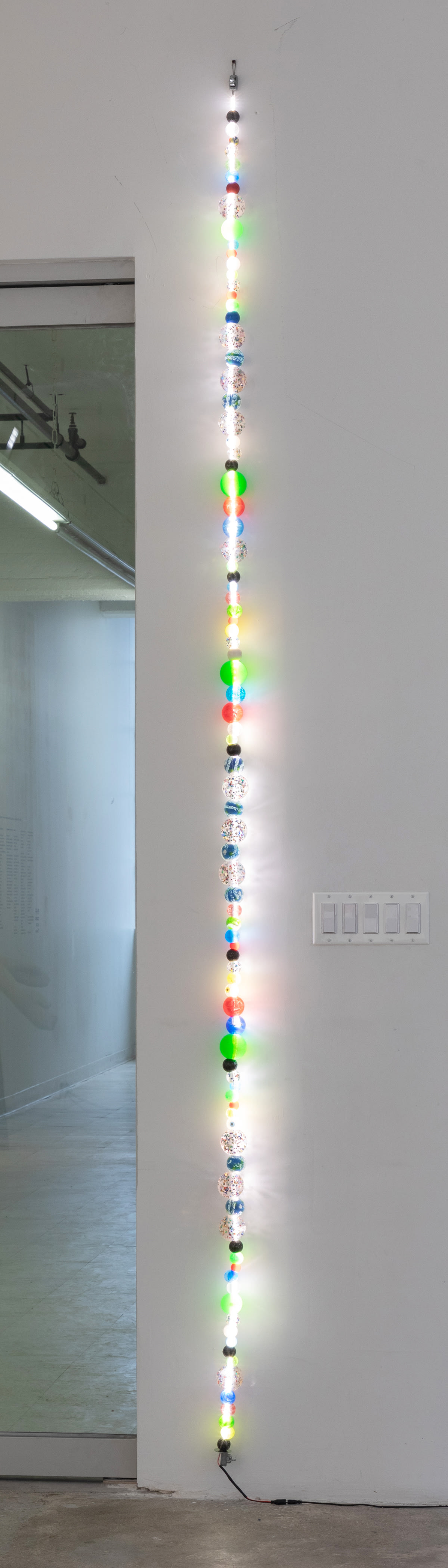 Jessie Stead Beaded Interludes vol. 30, 2019 Assorted synthetic rubber balls, LED lights, electronic wiring 120 x 2 1/2 in 304.8 x 6.3 cm