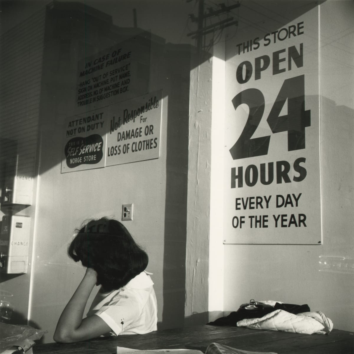 Arthur Tress, Woman in Laundromat, San Francisco, 1964