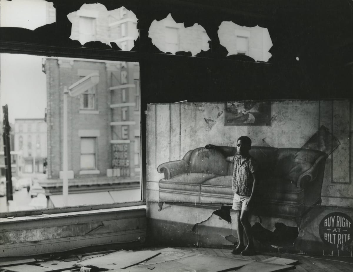 Arthur Tress, Boy in Burnt Out Furniture Store, Newark, NY, 1969