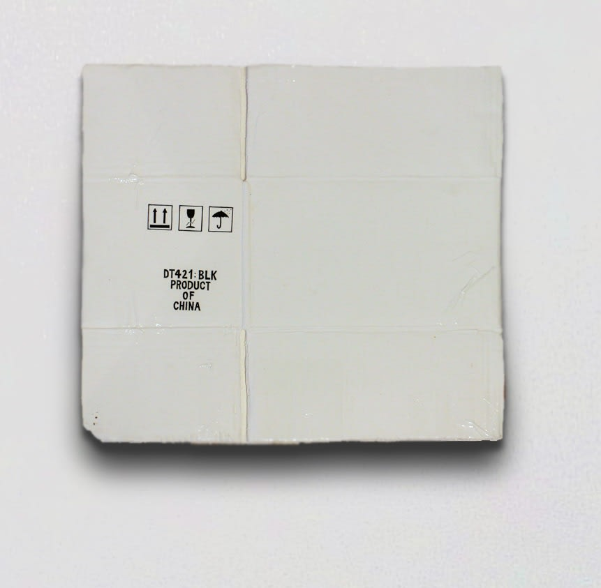 Marita Hewitt  Transaction (Product of China), 2013  Porcelain  14 x 16.5 x 0.8 in 35.5 x 42 x 2 cm