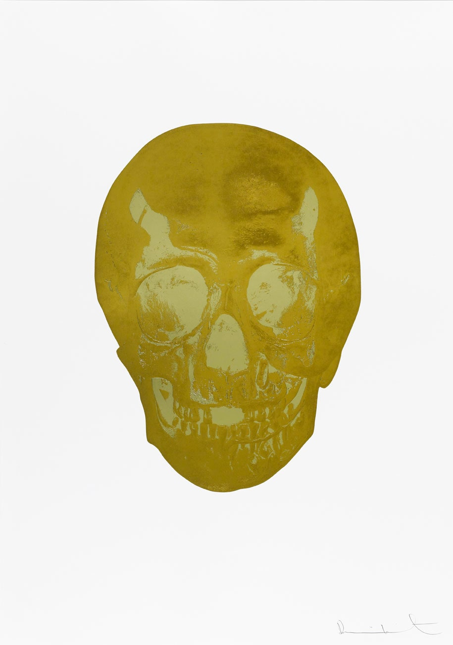 Damien Hirst Death Or Glory African Gold/Cool Gold Glorious Skull, 2011 2 colour foil block on 300gsm Arches 88 archival paper. Signed and numbered. Published by Paul Stolper and Other Criteria. White aluminium powder coated frame. 72 x 51 cm; Framed 76.8 x 55.8 cm OC8378 Edition of 2