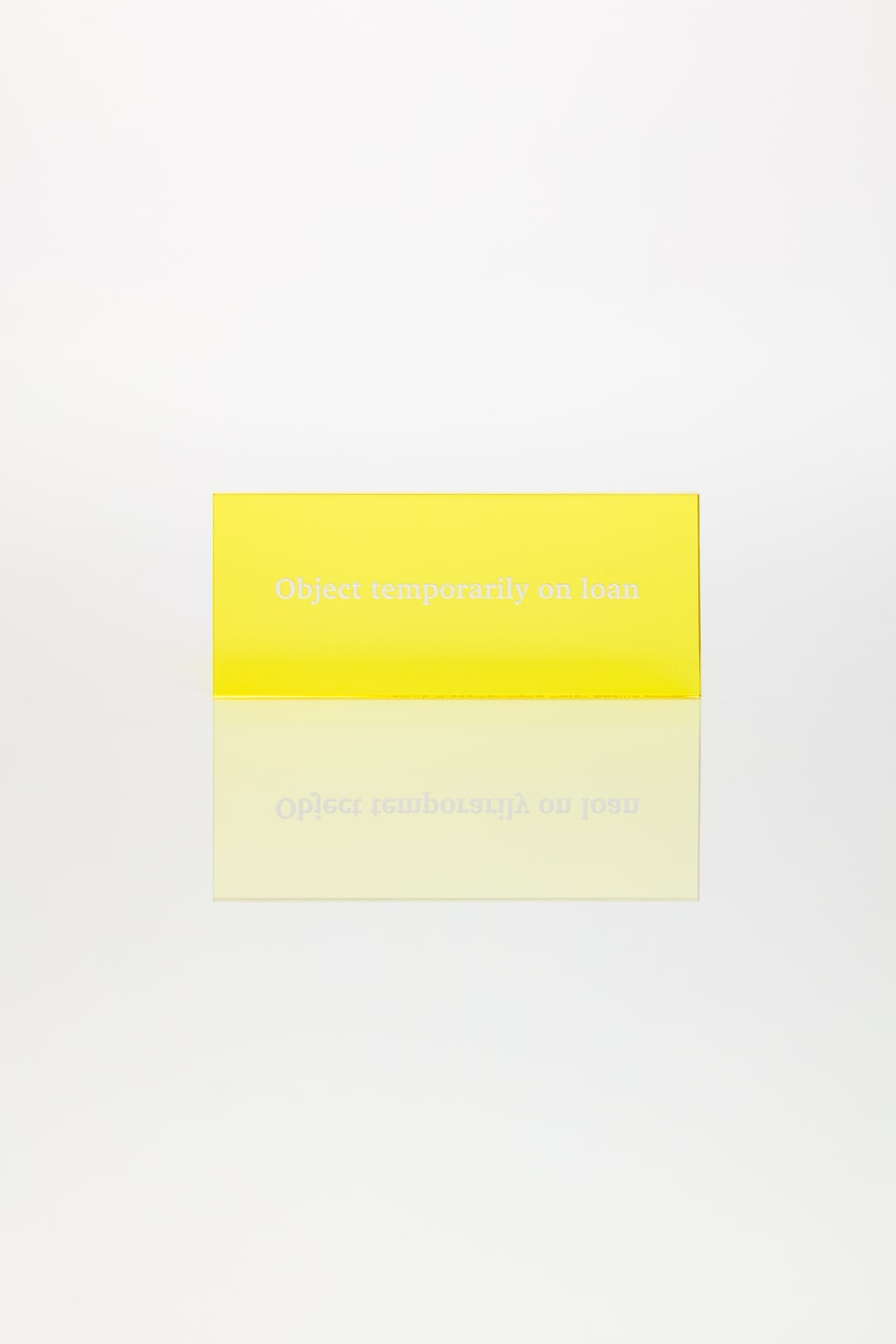 Anna Blessmann and Peter Saville Object temporarily on loan, 2013 Perspex vario tropical yellow 2T45 with white type engraved font. Accompanied by a signed certificate. 12 x 5 x 0.5 cm Edition of 20