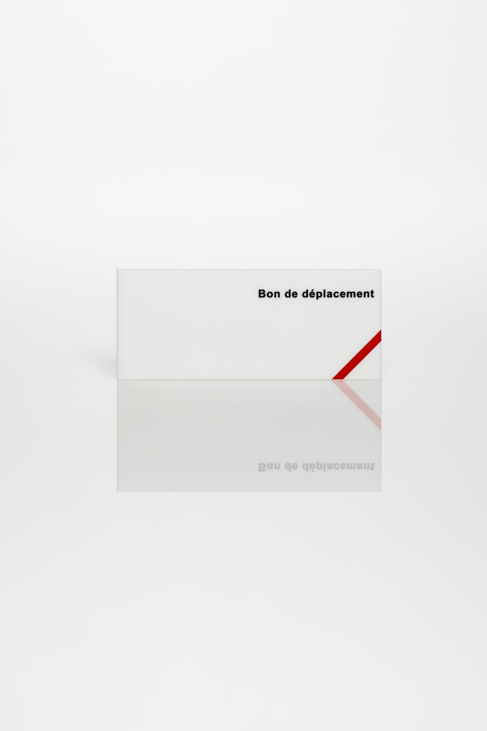 Anna Blessmann and Peter Saville Bon de déplacement, 2013 Opal 069 perspex with black type engraved font and pantone warm red C stripe. Accompanied by a signed certificate. 12 x 5 x 0.5 cm Edition of 20