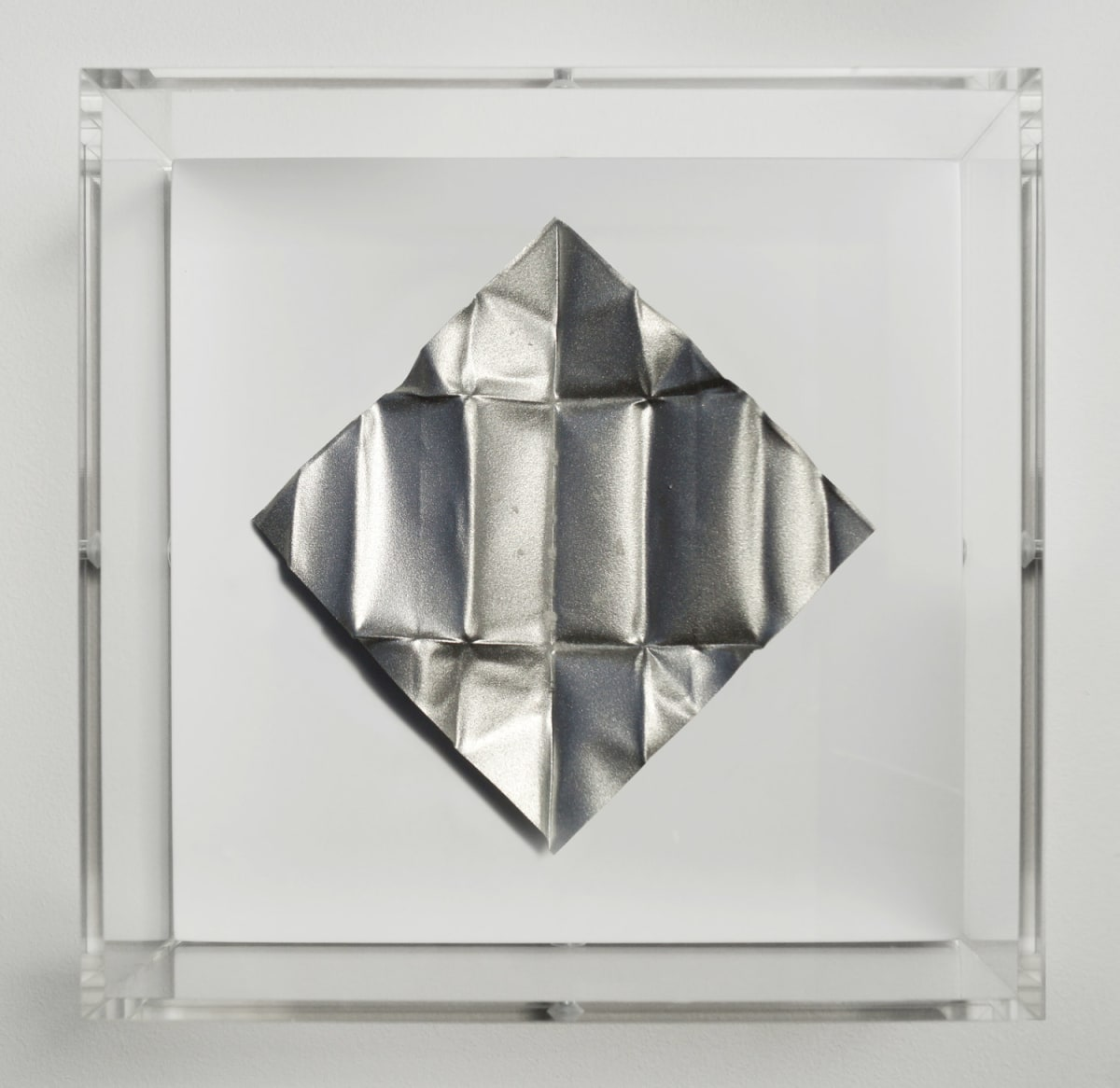 Mat Collishaw The Release - Silver Dollar, 2018 Diamond dust, folded aluminium, wood, acrylic, paint FRAMED 18.5 x 18.5 x 6.5 cm Edition of 10 Signed and numbered