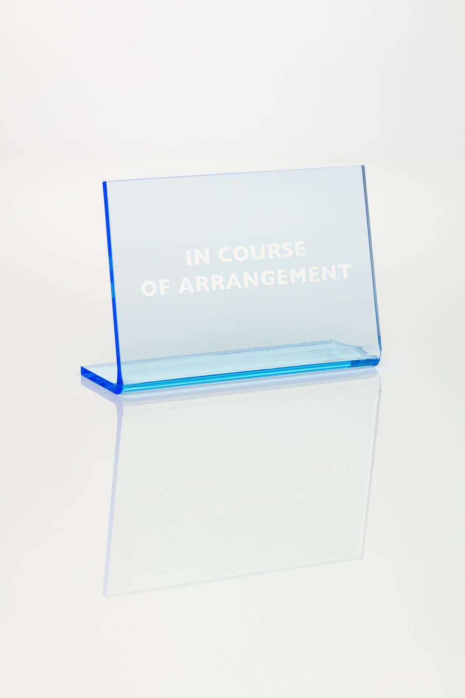 Anna Blessmann and Peter Saville In Course of Arrangement, 2013 Perspex vario cascade blue 7T5D with white type engraved font. Accompanied by a signed certificate. 15 x 10 x 0.5 cm Edition of 20