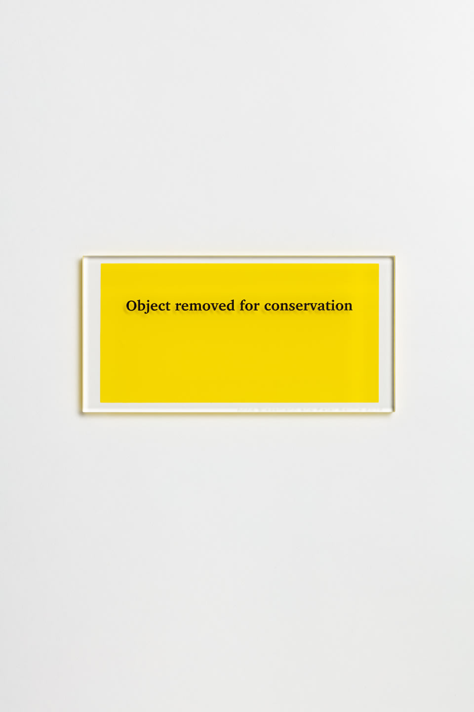 Anna Blessmann and Peter Saville Object removed for conservation, 2013 Clear 000 perspex with black type engraved font and pantone yellow C reverse, printed at 134mm wide x 67mm high. Accompanied by a signed certificate. 15 x 7.5 x 0.5cm Edition of 20