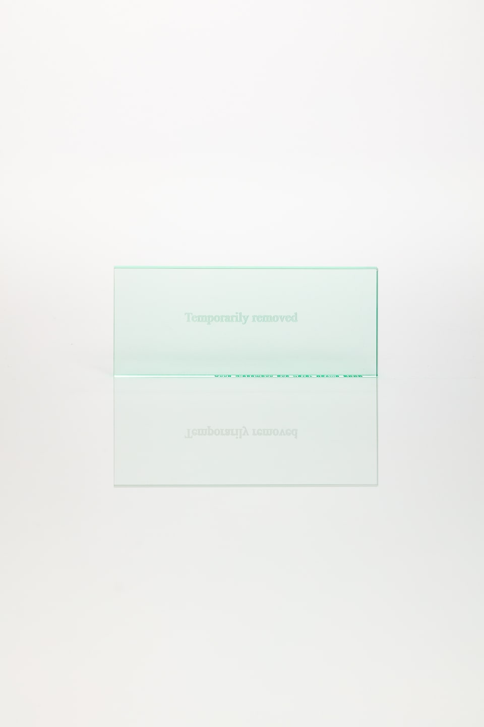 Anna Blessmann and Peter Saville Temporarily Removed, 2008 Green tinted clear acrylic, engraved text. Accompanied by a signed certificate. 5 x 12 x 0.3 cm Edition of 10