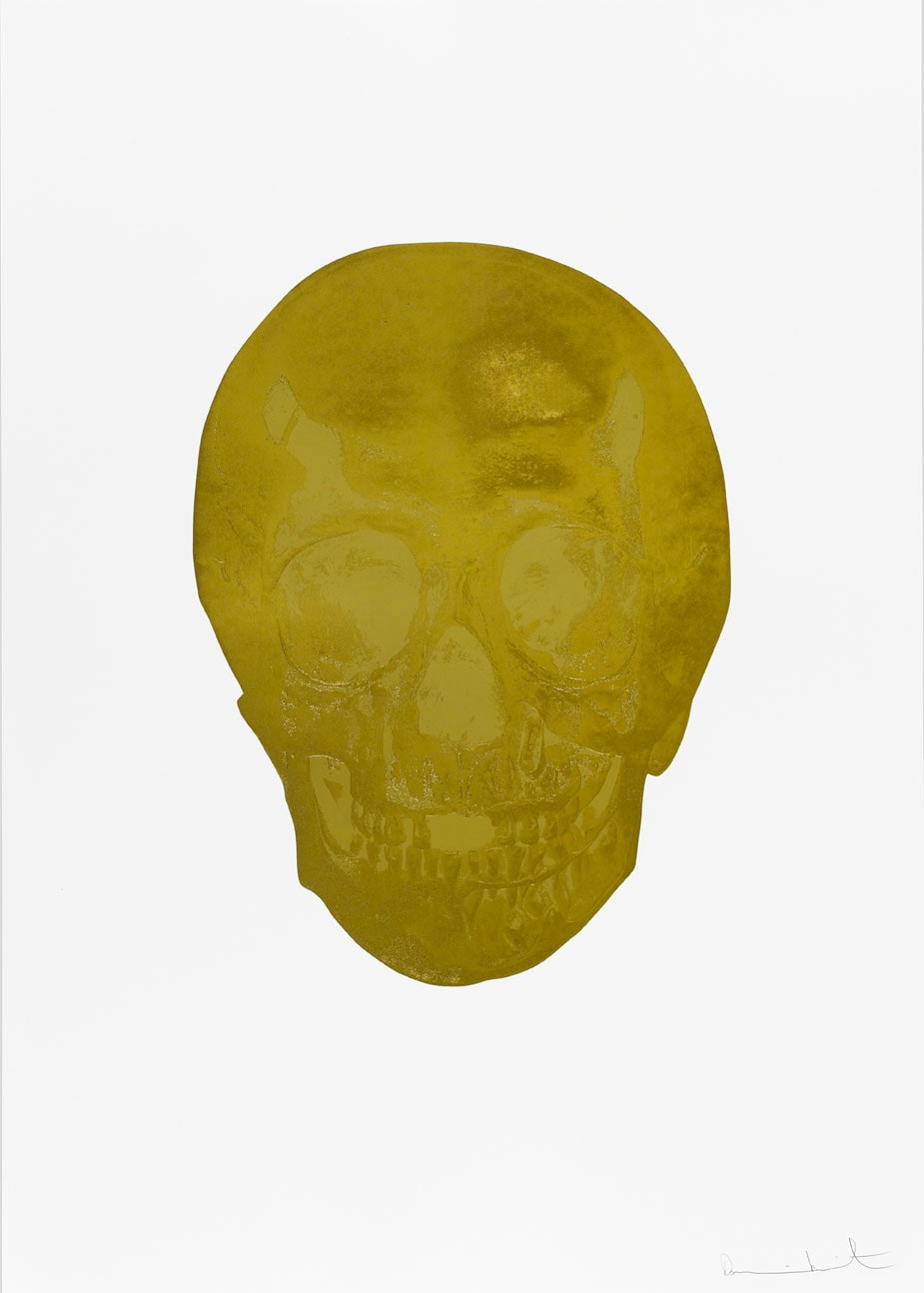 Damien Hirst Death Or Glory African Gold/Hazy Gold Glorious Skull, 2011 2 colour foil block on 300gsm Arches 88 archival paper. Signed and numbered. Published by Paul Stolper and Other Criteria. White aluminium powder coated frame. 72 x 51 cm; Framed 76.8 x 55.8 cm OC8377 Edition of 2