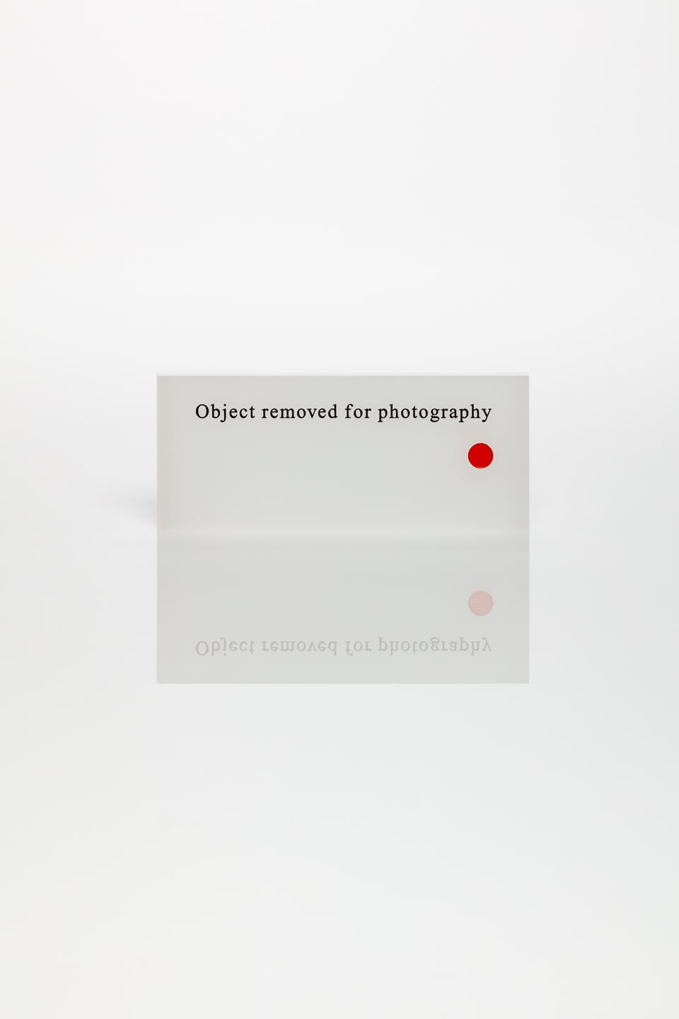 Anna Blessmann and Peter Saville Object removed for photography, 2008 Polar White, engraved text in filled in black, warm red dot. Accompanied by a signed certificate. 5 x 12 x 0.3 cm Edition of 10