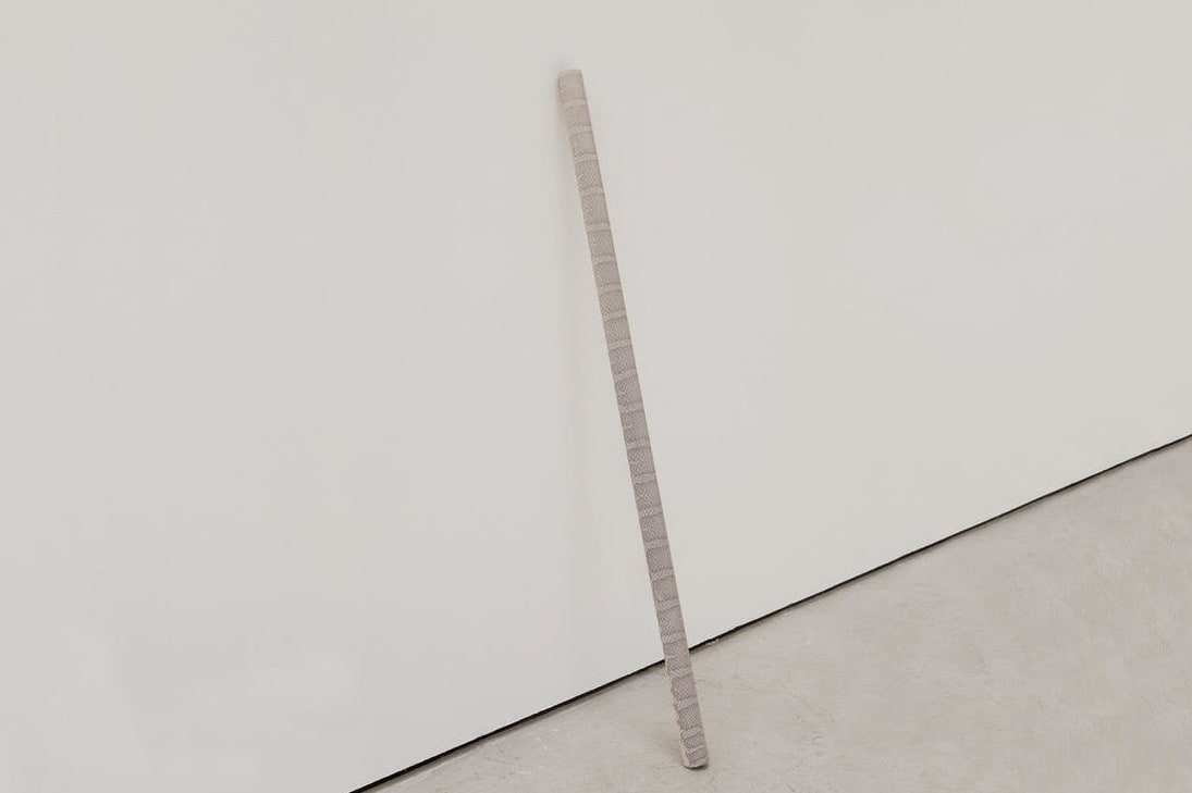 Alastair Mackie A.C.R.O.N.Y.M, 2013 Snakeskin, aluminium tube. Series of 3 200 x 3.5 x 3.5 cm