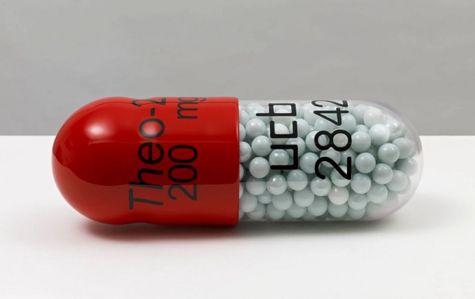 Damien Hirst Theo-24 200mg ucb 2842 Polyurethane resin with ink pigment. PETG vacuum formed shell filled with white glass marbles. 2014. Edition of 30. Numbered, signed and dated in the cast. Published by Paul Stolper and Other Criteria. OC10053 / DHS18298 L 30cm x diameter 11cm L 11.8 x diameter 4.3 Edition of 30