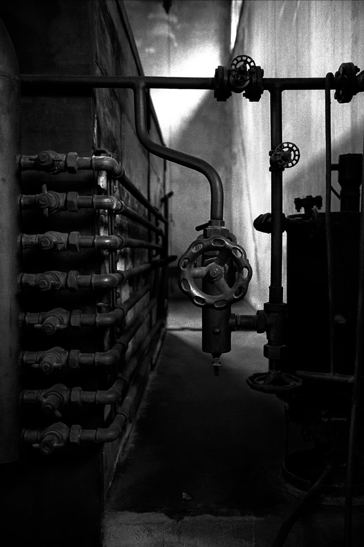 Judy Glickman Lauder Gas valves, crematoria, Theresienstadt concentration camp, Czech, 2018 Archival Pigment print 18 x 22""