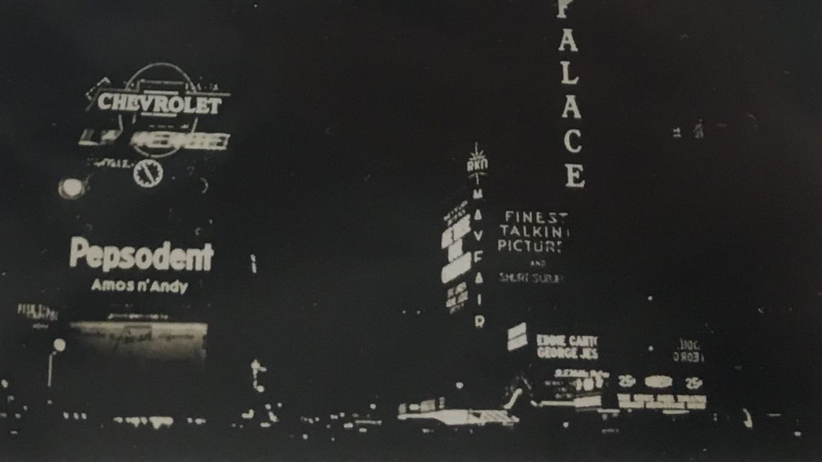 """Fred Zinnemann 1907-1997Times Square at Night, New York, 1932 """"Estate of Fred Zinnemann"""" & signed by his son Tim Zinnemann in pencil on verso Vintage gelatin silver print 2 9/16 x4 3/8 inches"""