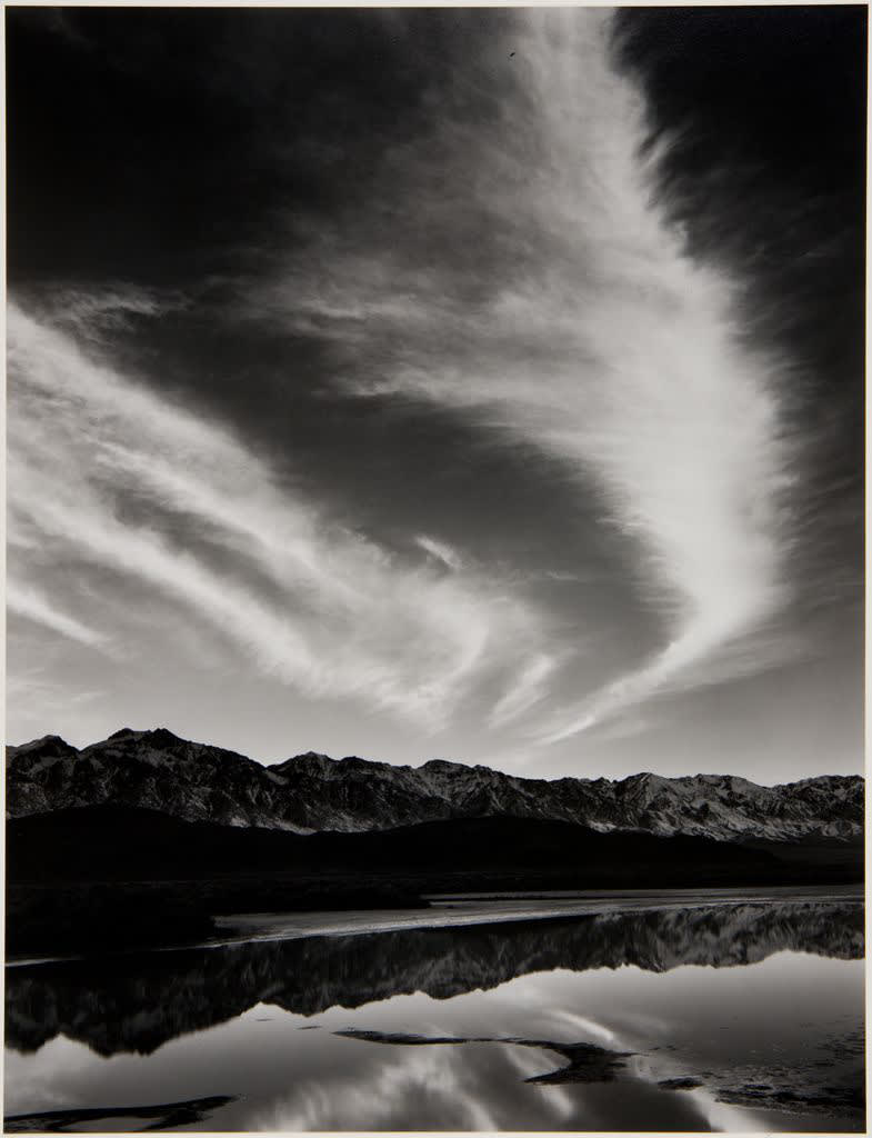Ansel Adams Sierra Nevada, Winter Evening, from the Owens Valley, California, 1962 Gelatin Silver Print Mount 18 x 14 inches; Image 11 5/8 x 9 inches © Ansel Adams. Courtesy of the Ansel Adams Publishing Trust
