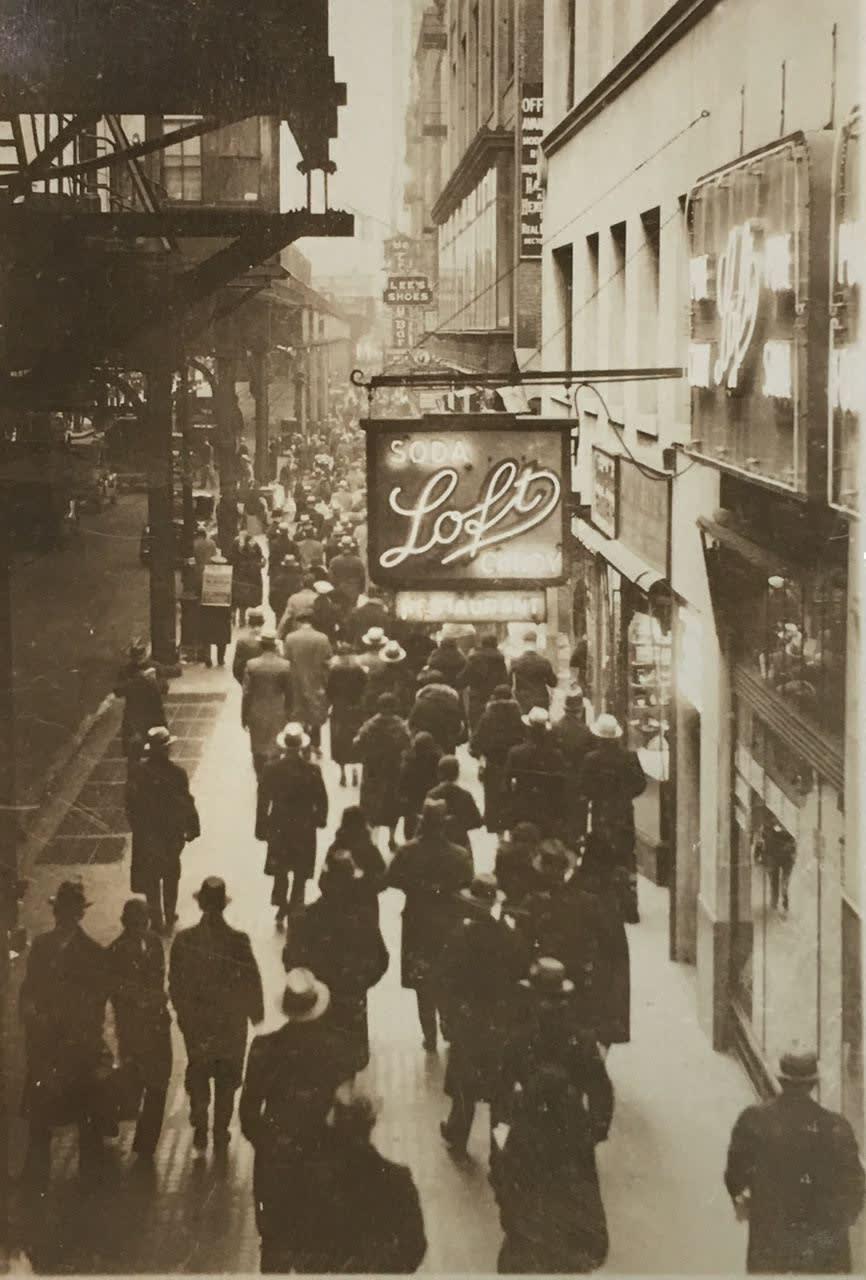 Fred Zinnemann Untitled [Loft sign on street], n.d. Vintage gelatin silver print 2 7/8 x 2 inches