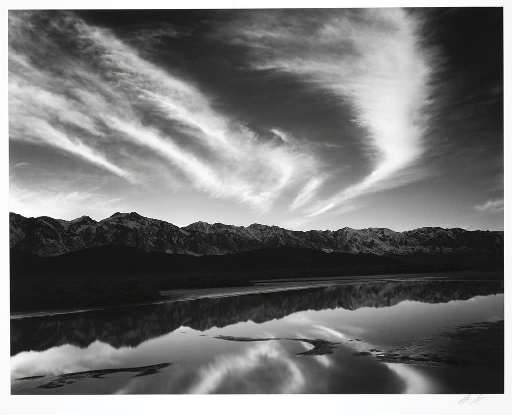 "Ansel Adams Evening Clouds and Pool, East Side of the Sierra from the Owens Valley, CA, 1962 (Printed 1980) Gelatin Silver Print Image - 15.25""x19.5"", Mount 22""x28"", Matted - 24""x30"" © Ansel Adams. Courtesy of the Ansel Adams Publishing Trust"