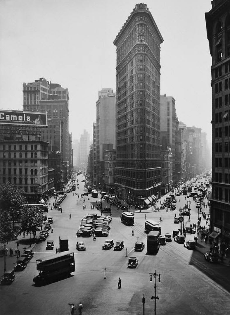 "Berenice Abbott 1898-1991Flatiron Building, New York City, 1934 (Printed 1982) Signed and numbered in pencil on recto. Photographer's stamp on mount verso. Gelatin Silver Print Image - 17.5""x23"", Mount - 27""x33"", Matted - 28""x34"""