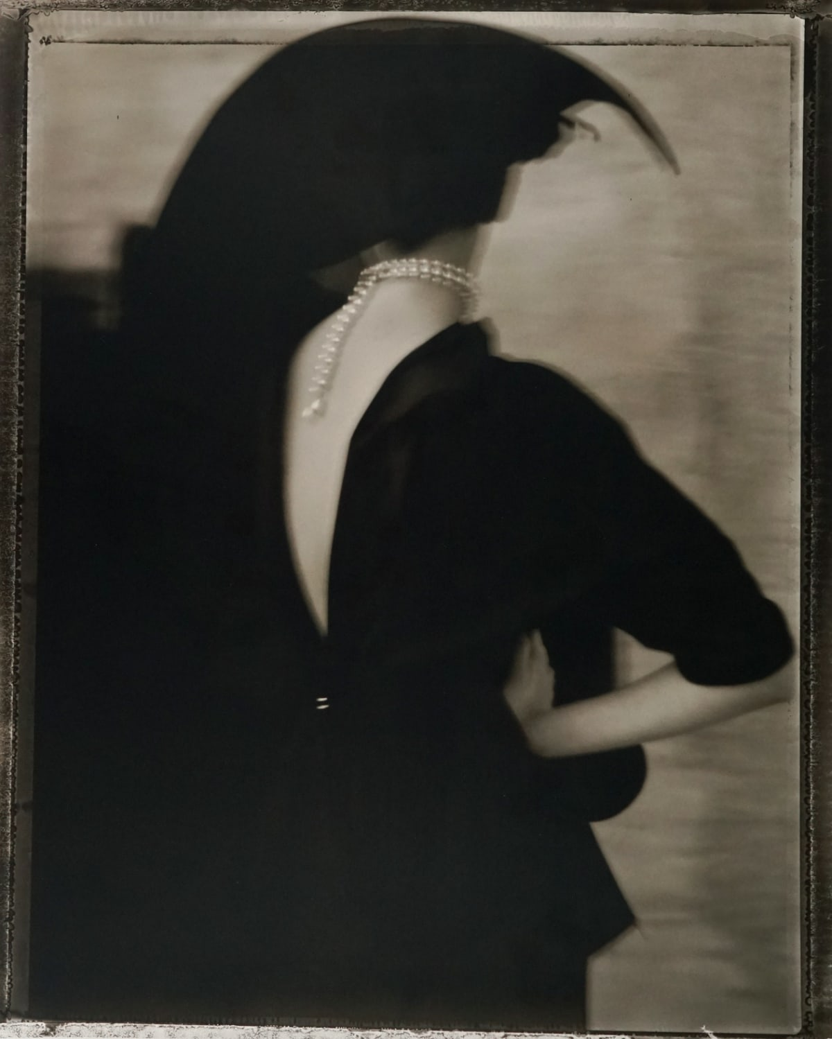 "Sarah Moon 1941L'inconnue, 2011 Signed, titled, dated, numbered on verso Gelatin Silver Print Image - 17.5""x21.75"", Paper - 20""x24"", Matted - 24""x30"" Edition 9 of 20"