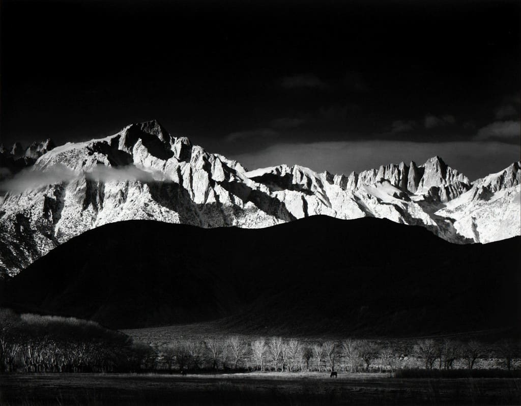 "Ansel Adams Winter Sunrise, Sierra Nevada from Lone Pine, CA, 1944 (Printed 1970's) Gelatin Silver Print Image - 15.25""x19.5"", Mount 22""x28"", Matted - 24""x30"" © Ansel Adams. Courtesy of the Ansel Adams Publishing Trust"