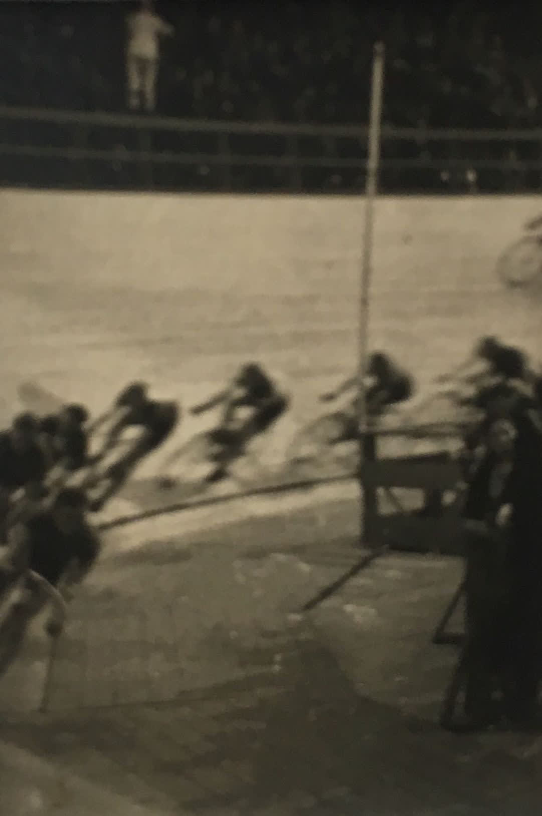 """Fred Zinnemann 1907-1997Bicycle Race, Madison Square Garden, 1932 """"Estate of Fred Zinnemann"""" & signed by his son Tim Zinnemann in pencil on verso Vintage gelatin silver print 1 3/8 x 1 inches"""