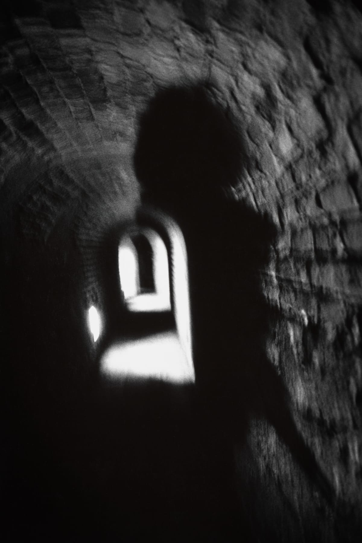 Judy Glickman Lauder Photographer's shadow, underground tunnel, Theresienstadt concentration camp, Czech, 2018 Archival Pigment print 18 x 22""