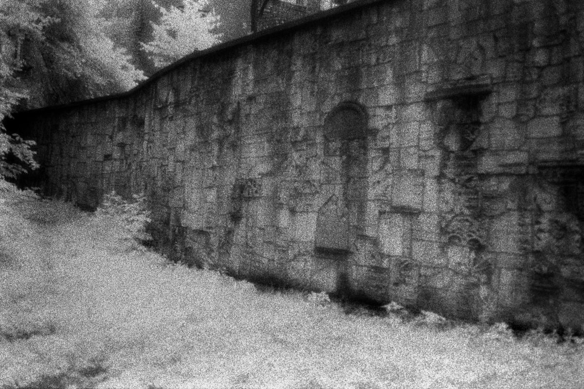 Judy Glickman Lauder Wall constructed from desecrated Jewish gravestones, Krakowof Gravestones, Krakow, Poland, 2018 Archival Pigment print 18 x 22""
