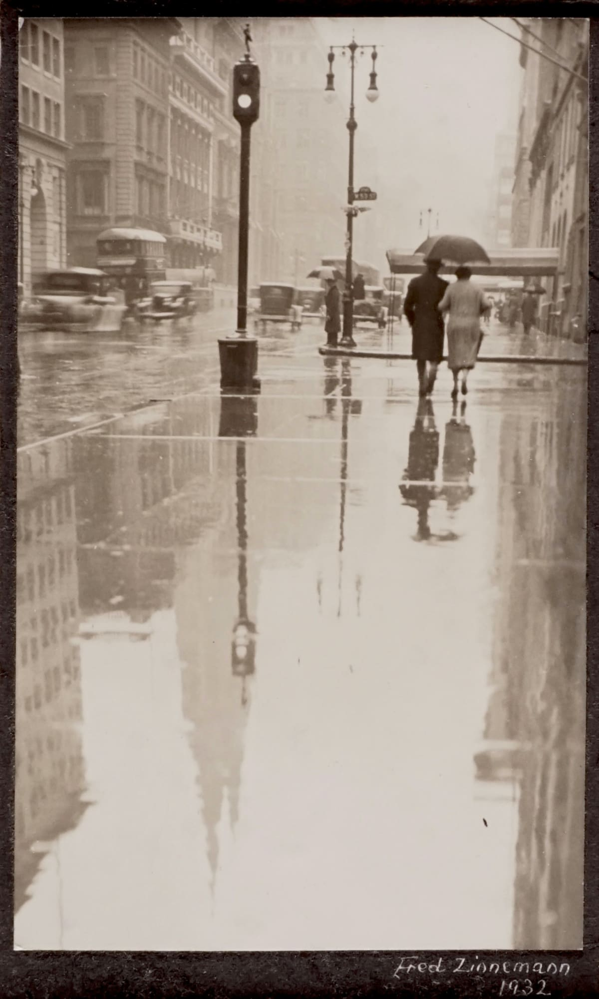 Fred Zinnemann Rainy Day, Fifth Avenue, New York, 1932 Vintage gelatin silver print 6 x 3 3/4 inches; Signed & dated in ink on recto
